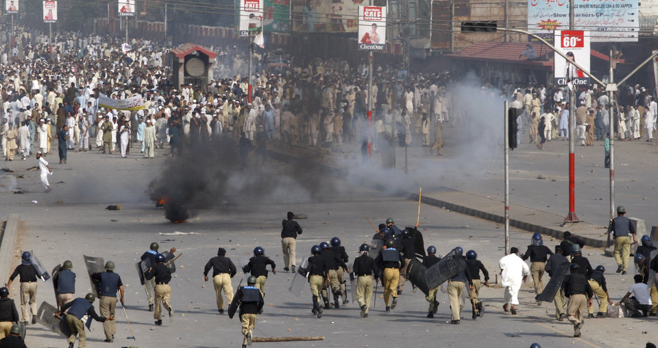 "Police chase protesters during an anti-U.S. rally in Peshawar, Pakistan, Friday, Sept 21, 2012. Tens of thousands protested around the country against an anti-Muslim film after the government encouraged peaceful protests and declared a national holiday --? ""Love for the Prophet Day."" Demonstrations turned violent and over a dozen people were killed. AP photo"