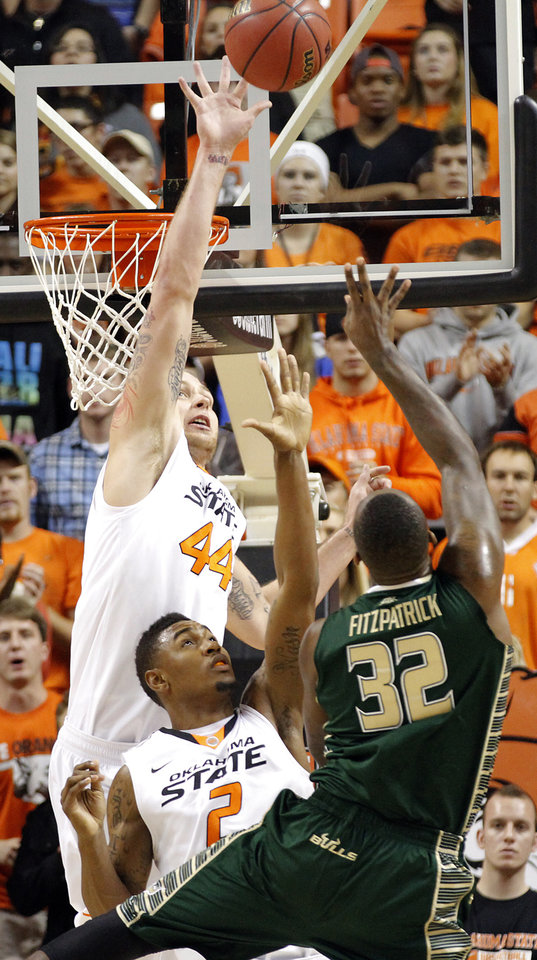 Photo - Oklahoma State 's Philip Jurick (44) and Le'Bryan Nash (2) defend a shot by South Florida Bulls' Toarlyn Fitzpatrick (32) during the college basketball game between Oklahoma State University (OSU) and the University of South Florida (USF) on Wednesday , Dec. 5, 2012, in Stillwater, Okla.   Photo by Chris Landsberger, The Oklahoman