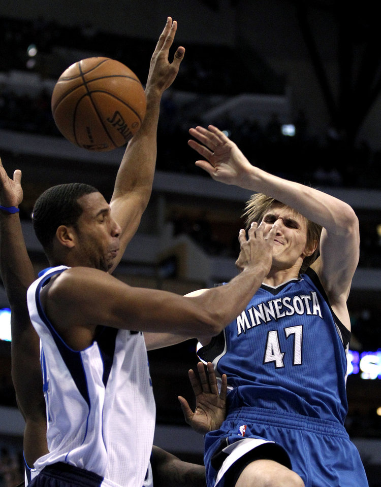 Dallas Mavericks\' Brandan Wright, left, breaks up a drive to the basket by Minnesota Timberwolves\' Andrei Kirilenko (47), of Russia, during the first half of an NBA basketball game, Monday, Nov. 12, 2012, in Dallas. (AP Photo/Tony Gutierrez)