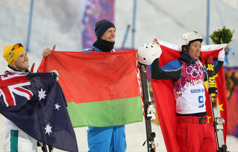 Photo - Men's freestyle skiing aerials medalists from left, Australia's David Morris (silver), Anton Kushnir of Belarus (gold), and China's China's Jia Zongyang (bronze), pose for photographers on the podium during a flower ceremony at the Rosa Khutor Extreme Park, at the 2014 Winter Olympics, Monday, Feb. 17, 2014, in Krasnaya Polyana, Russia.(AP Photo/Sergei Grits)