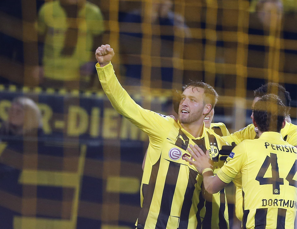 Photo - Dortmund's Julian Schieber celebrates after scoring during the Champions League Group D soccer match between Borussia Dortmund and Manchester City  in Dortmund, Germany, Tuesday, Dec. 4, 2012. (AP Photo/Frank Augstein)