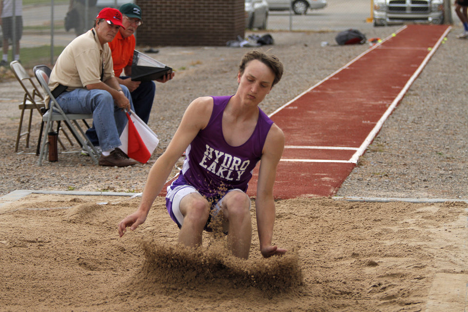 Photo - HIGH SCHOOL TRACK AND FIELD: Josh Langley, of Hydro Eakly, participates in Class A boys long jump during a track meet at Carl Albert High School in Midwest City, Friday, May 4, 2012.  Photo by Garett Fisbeck, For The Oklahoman