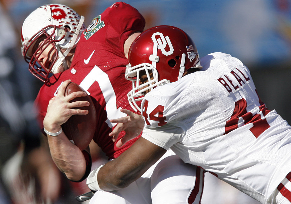 Oklahoma's Jeremy Beal, right, brings down Stanford's Toby Gerhart during Thursday's Sun Bowl. Photo by Chris Landsberger, The Oklahoman