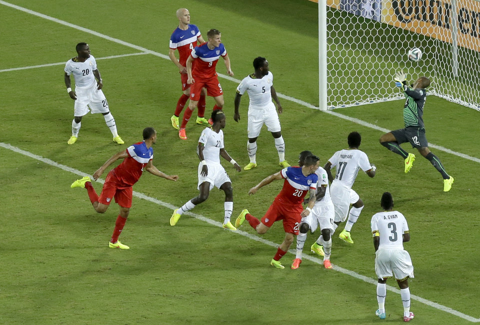 United States\' John Brooks, second from left, scores his side\'s second goal during the group G World Cup soccer match between Ghana and the United States at the Arena das Dunas in Natal, Brazil, Monday, June 16, 2014. The United States defeated Ghana 2-1.(AP Photo/Hassan Ammar)