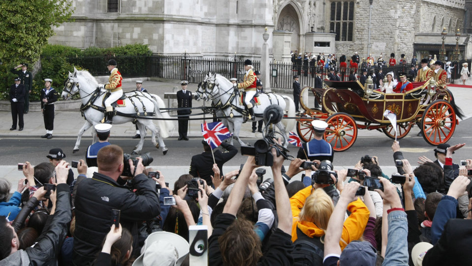 Photo - Britain's Prince William and his wife Kate, Duchess of Cambridge, are photographed as they leave Westminster Abbey at the Royal Wedding in London Friday, April 29, 2011. (AP Photo/Alastair Grant)  ORG XMIT: RWFO156