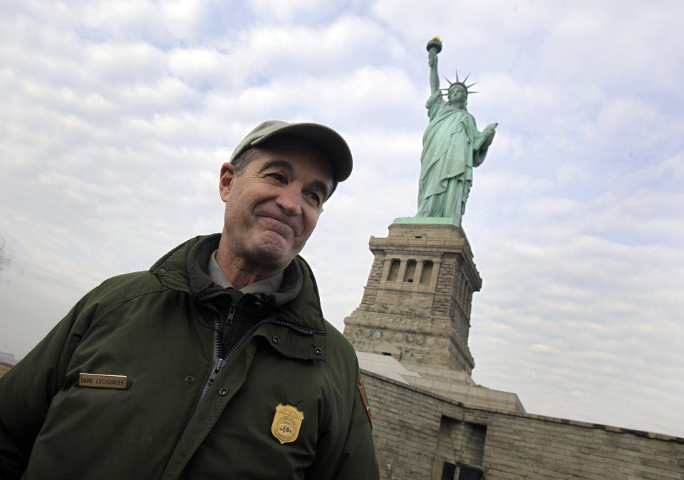 Photo - David Luchsinger, superintendent of Statue of Liberty National Monument, and last resident of Liberty Island, poses for a photo during a tour of the venue, in New York,  Friday, Nov. 30, 2012. Tourists in New York will miss out for a while on one of the hallmarks of a visit to New York,  seeing the Statue of Liberty up close. Though the statue itself survived Superstorm Sandy intact, damage to buildings and Liberty Island's power and heating systems means the island will remain closed for now, and authorities don't have an estimate on when it will reopen. (AP Photo/Richard Drew)