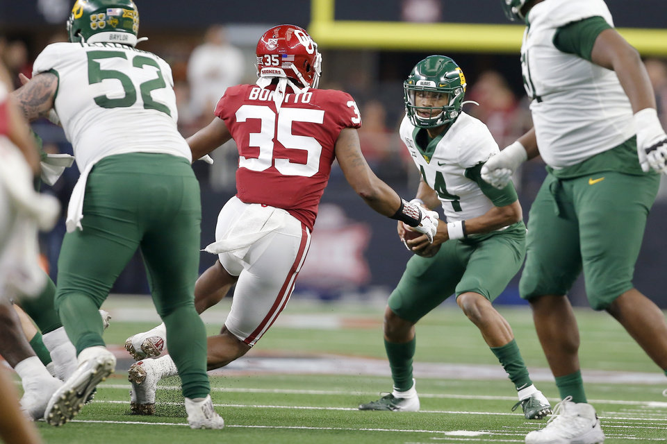 Photo - Oklahoma's Nik Bonitto (35) puts pressure on Baylor's Jacob Zeno (14) during overtime of the Big 12 Championship Game between the University of Oklahoma Sooners (OU) and the Baylor University Bears at AT&T Stadium in Arlington, Texas, Saturday, Dec. 7, 2019. Oklahoma won 30-23. [Bryan Terry/The Oklahoman]