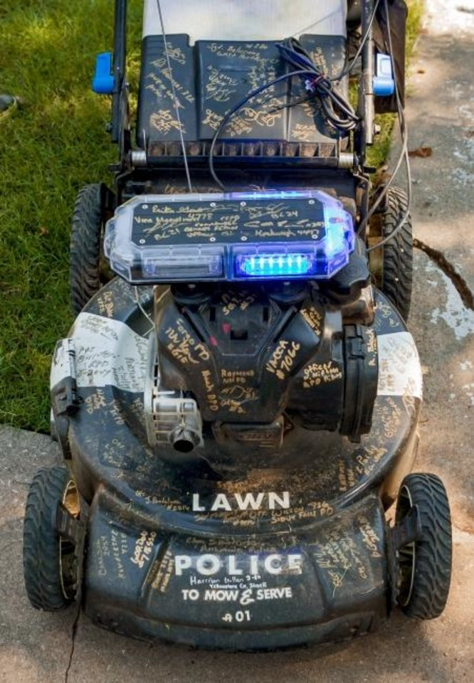 Photo -  Rodney Smith's lawn mower sports a light bar like those atop police cars. [Chris Landsberger/The Oklahoman]