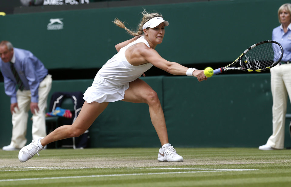 Photo - Eugenie Bouchard of Canada plays a return to Petra Kvitova of the Czech Republic during the women's singles final at the All England Lawn Tennis Championships in Wimbledon, London, Saturday, July 5, 2014. (AP Photo/Sang Tan)