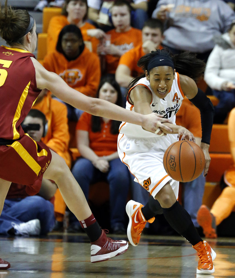 Photo - Oklahoma State's Tiffany Bias (3) grabs a loose ball from Iowa State's Hallie Christofferson (5) during the women's college basketball game between Oklahoma State and Iowa State at  Gallagher-Iba Arena in Stillwater, Okla.,  Sunday,Jan. 20, 2013. Photo by Sarah Phipps, The Oklahoman