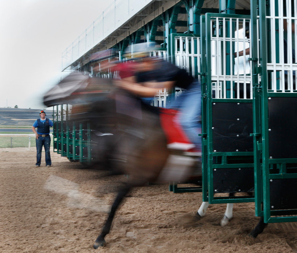 Photo - A racehorse leaves the gate  at Remington Park Racetrack on Tuesday morning,  Aug. 16, 2011.  by Jim Beckel, The Oklahoman.  ORG XMIT: KOD