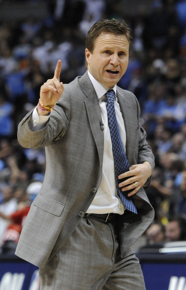 Photo - Oklahoma City Thunder head coach Scott Brooks looks on during the second half of game 3 of a first-round NBA basketball playoff series against the Denver Nuggets Saturday, April 23, 2011, in Denver. Oklahoma City beat Denver 97-94 to take a 3-0 series lead. (AP Photo/Jack Dempsey)