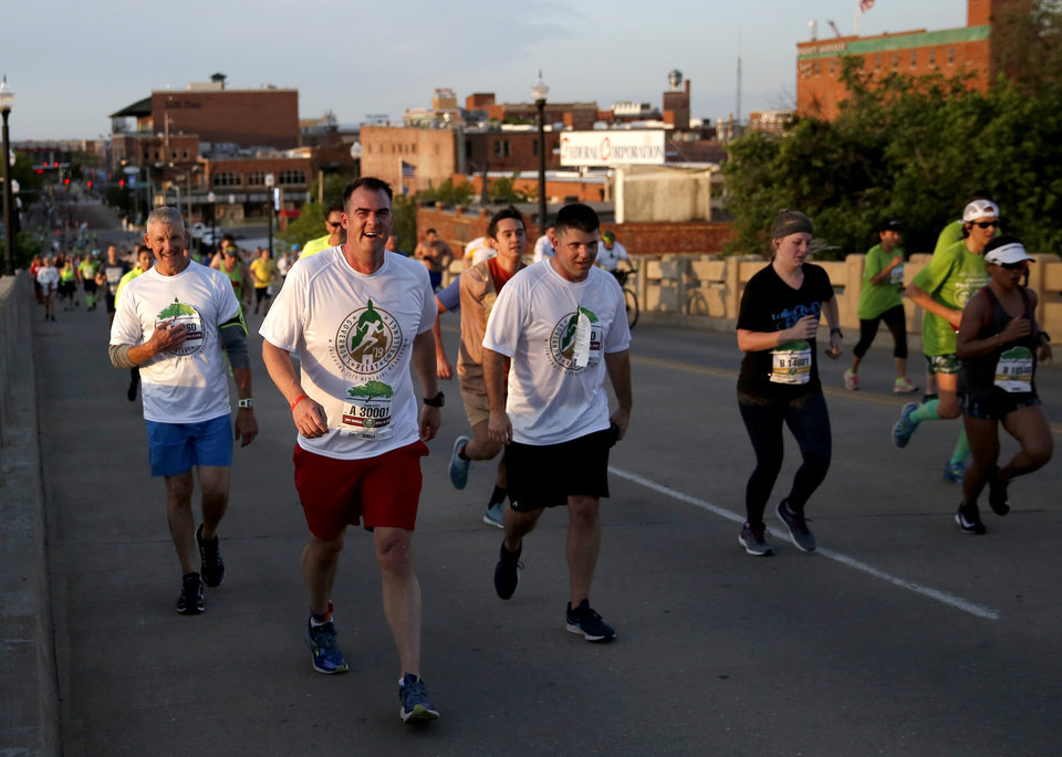 Photo - Gov. Kevin Stitt runs up the Walnut Street during Oklahoma City Memorial Marathon in Oklahoma City, Sunday, April 28, 2019. [Sarah Phipps/The Oklahoman]