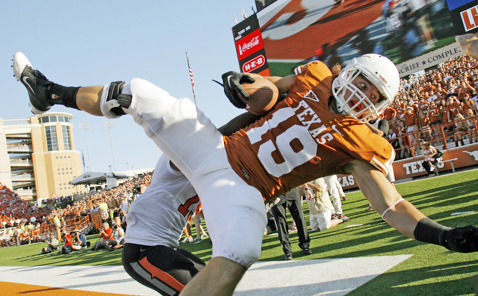 Photo - UT's Blaine Irby (19) grabs the ball but is out of the end zone as OSU's Brodrick Brown (19) defends in the fourth quarter during a college football game between the Oklahoma State University Cowboys (OSU) and the University of Texas Longhorns (UT) at Darrell K Royal-Texas Memorial Stadium in Austin, Texas, Saturday, Oct. 15, 2011. OSU won, 38-26. Photo by Nate Billings, The Oklahoman