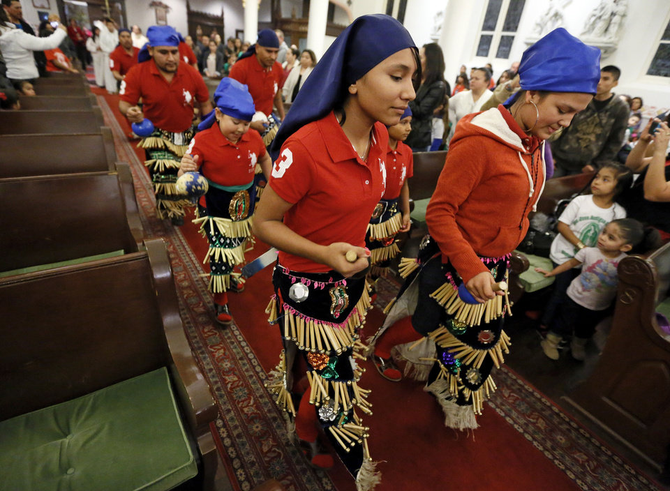 Matachines dance at the beginning of Mass during the Feast of Our Lady of Guadalupe at St. Joseph Old Cathedral, 307 NW 4, in Oklahoma City on Wednesday. Photo by Nate Billings, The Oklahoman