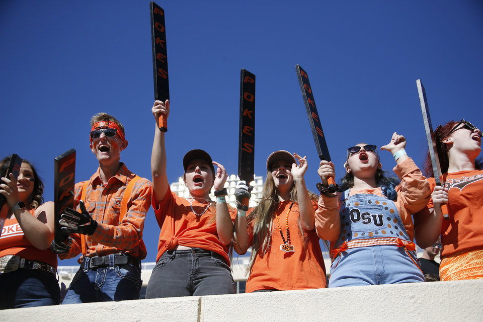 Photo - OSU fans cheer during warm ups before the college football game between the Oklahoma State University Cowboys and the TCU Horned Frogs at Boone Pickens Stadium in Stillwater, Okla.,  Saturday, Nov. 2, 2019. [Sarah Phipps/The Oklahoman]