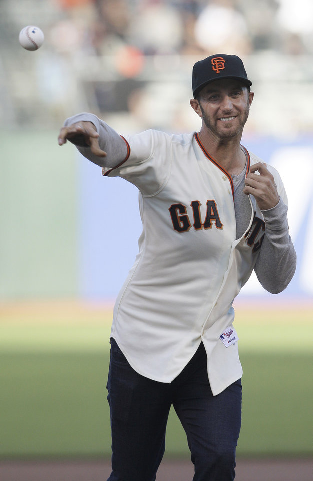 Photo -   Golfer Dustin Johnson throws out the cermonial first pitch before a baseball game between the San Francisco Giants and the Houston Astros in San Francisco, Wednesday, June 13, 2012. (AP Photo/Jeff Chiu)