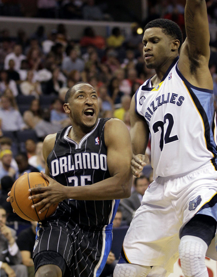 Orlando Magic's Chris Duhon (25) is defended by Memphis Grizzlies' Rudy Gay (22) during the first half of an NBA basketball game in Memphis, Tenn., Thursday, April 26, 2012. (AP Photo/Danny Johnston)