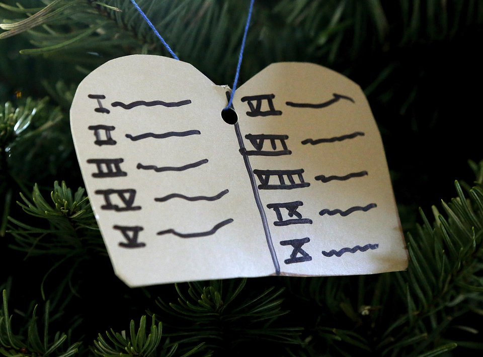 A Ten Commandments ornament represents Moses on the Jesse tree.