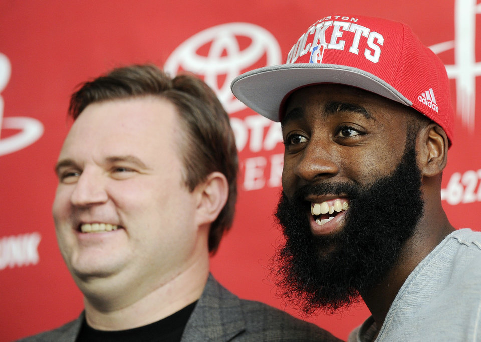 Houston Rockets general manager Daryl Morey, left, and James Harden pose for photographers at an NBA basketball news conference, Monday, Oct. 29, 2012, in Houston. (AP Photo/Pat Sullivan)