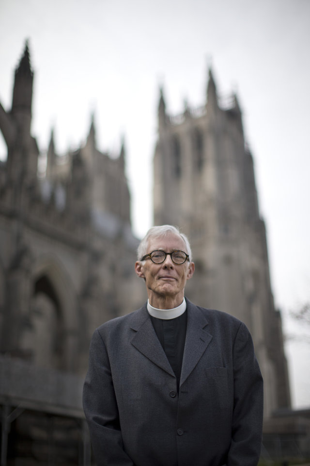 Rev. Gary Hall, dean of the Washington National Cathedral, stands outside the church in Washington, Wednesday, Jan. 9, 2013. The Washington National Cathedral, where the nation gathers to mourn tragedies and celebrate new presidents, will soon begin performing same-sex marriages. (AP Photo/ Evan Vucci)