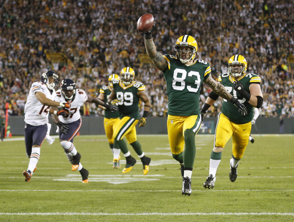 Photo -   Green Bay Packers' Tom Crabtree (83) celebrates as he scores a touchdown on a pass from punter Tim Masthay during the first half of an NFL football game against the Chicago Bears Thursday, Sept. 13, 2012, in Green Bay, Wis. (AP Photo/Jeffrey Phelps)