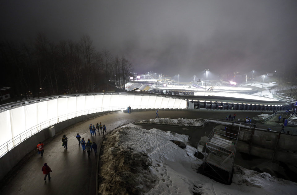 Photo - Fog settles in the Sanki Sliding Center during the men's two-man bobsled competition at the 2014 Winter Olympics, Sunday, Feb. 16, 2014, in Krasnaya Polyana, Russia. (AP Photo/Natacha Pisarenko)