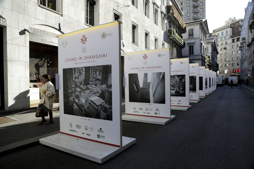 Photo -  The photo exhibition' Living in Shangai' is displayed at the Montenapoleone shopping district, in Milan, Italy, Tuesday, Feb. 4, 2020.  China's virus outbreak is giving global business a chill. In Milan's luxury Montenapoleone shopping district, dozens of luxury brands decked out their windows for Chinese New Year. But wealthy Chinese shoppers, who are responsible for about one-third of all luxury purchases globally, have failed to arrive in their usual numbers. (AP Photo/Luca Bruno)