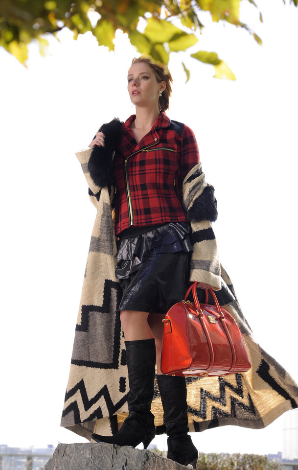 Slip on a second skin of fur or leather this season. Here, Ralph Lauren sweater wrap, Raplhlauren.com, $2,850; Ragdolls Couture black vegan leather asymmetrical tier skirt, Doll House, $179; Kate Spade earrings, Handbags In The City, $98; Donald Pliner boots, Matava, $395; 525 America plaid and leather biker jacket, Cupcake, $189. (Lloyd Fox/Baltimore Sun/MCT)