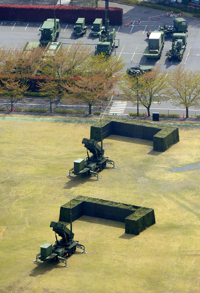 Photo - This aerial photo shows units of Japan Air Self-Defense Force's PAC-3s deployed at Defense Ministry in Tokyo Tuesday, April 9, 2013. Japan has deployed missile interceptors in key locations around Tokyo as a precaution against a possible North Korean ballistic missile tests. (AP Photo/Kyodo News) JAPAN OUT, MANDATORY CREDIT, NO LICENSING IN CHINA, HONG KONG, JAPAN, SOUTH KOREA AND FRANCE