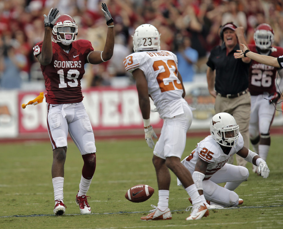 OU\'s Justin Brown (19) calls for the flag after getting his face masked pulled by the texas defense during the Red River Rivalry college football game between the University of Oklahoma (OU) and the University of Texas (UT) at the Cotton Bowl in Dallas, Saturday, Oct. 13, 2012. Photo by Chris Landsberger, The Oklahoman