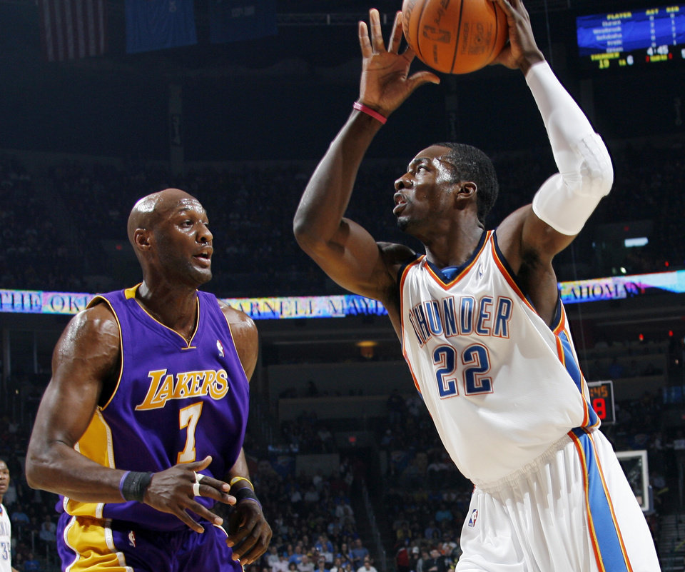 Oklahoma City\'s Jeff Green (22) tries to get the ball past Lama Odom (7) of Los Angeles during the NBA basketball game between the Los Angeles Lakers and the Oklahoma City Thunder at the Ford Center in Oklahoma City, Friday, March 26, 2010. Photo by Nate Billings, The Oklahoman