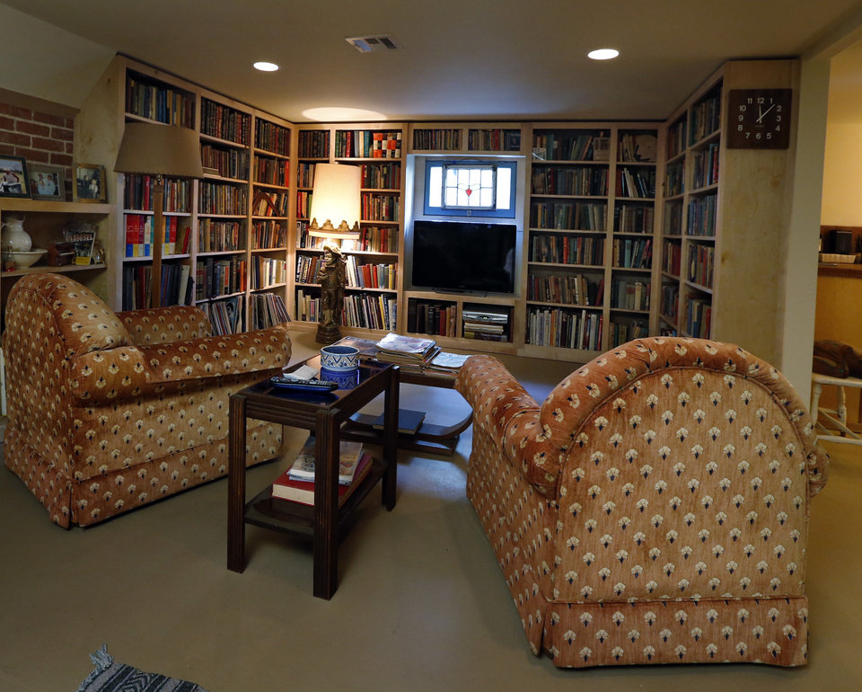 Photo -  Michael Brinkley and Lynda Donley's basement is a living area complete with personal library, antiques and collectibles. PHOTO BY STEVE SISNEY, THE OKLAHOMAN   STEVE SISNEY -  THE OKLAHOMAN