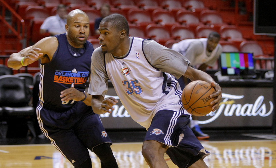 Oklahoma City's Kevin Durant drives past Oklahoma City's Derek Fisher, left, during practice for Game 3 of the NBA Finals between the Oklahoma City Thunder and the Miami Heat at American Airlines Arena in Miami, Saturday, June 16, 2012. Photo by Bryan Terry, The Oklahoman