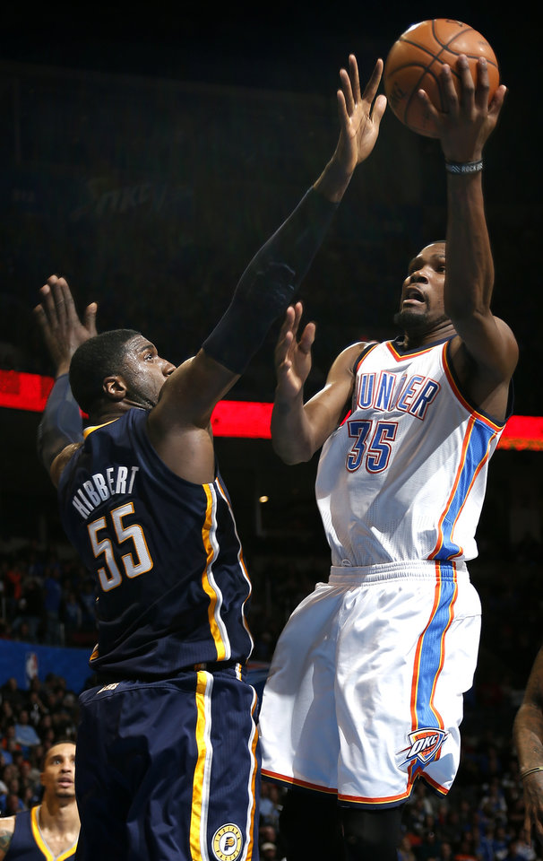 Photo - Oklahoma City's Kevin Durant (35) shoots over Indiana's Roy Hibbert (55) during the NBA game between the Oklahoma City Thunder and the Indiana Pacers at the Chesapeake Energy Arena, Sunday, Dec. 8, 2013. Photo by Sarah Phipps, The Oklahoman