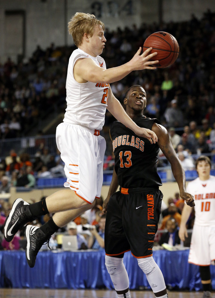 Roland's Brooks Robertson passes around Glenn Banks during the 4a boys championship game where the Douglass high school Trojans play the Roland Rangers at the State Fair Arena on Saturday, March 9, 2013 in Oklahoma City, Okla.  Photo by Steve Sisney, The Oklahoman