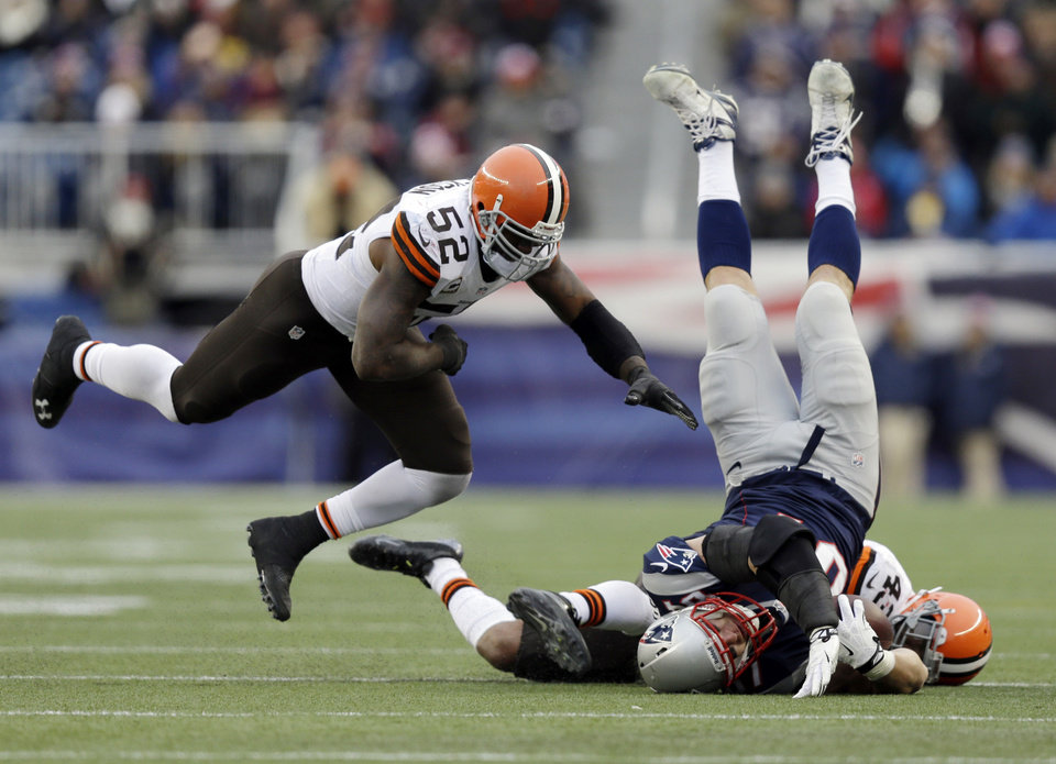 Cleveland Browns safety T.J. Ward (43) and linebacker D'Qwell Jackson (52) tackle New England Patriots tight end Rob Gronkowski (87) after a catch in the third quarter of an NFL football game Sunday, Dec. 8, 2013, in Foxborough, Mass. (AP Photo/Steven Senne)