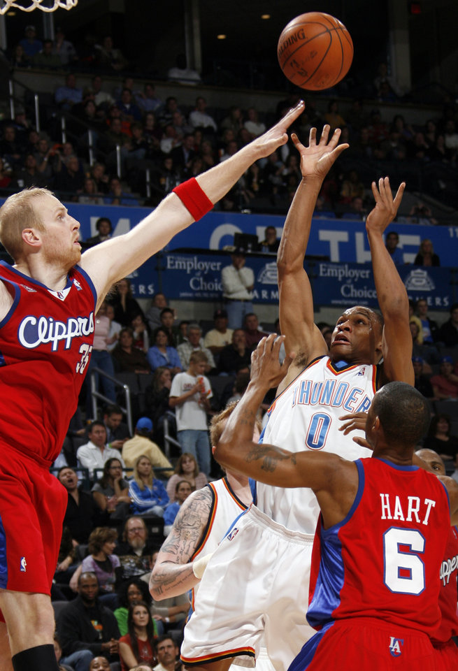 Photo - Russell Westbrook of the Thunder shoots between Chris Kaman, left, and Jason Hart of the Clippers in the second half of the NBA basketball game between the Oklahoma City Thunder and the Los Angeles Clippers at the Ford Center in Oklahoma City, Wednesday, Nov. 19, 2008. The Clippers won. 108-88. BY NATE BILLINGS, THE OKLAHOMAN