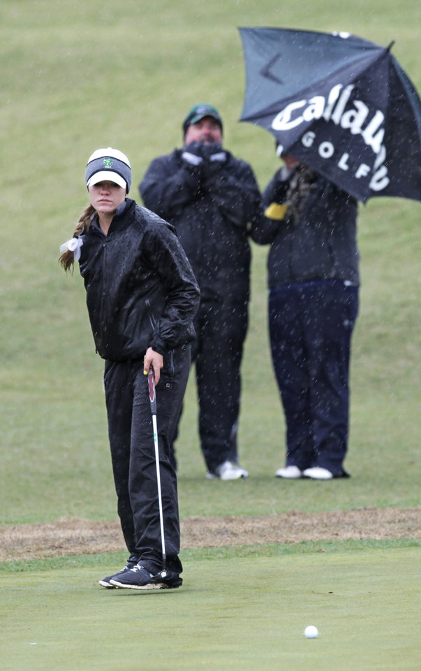 Photo - Edmond Santa Fe's Brinn Farriss putts on the second day of Girls 6A golf tournament, Thursday, May 2, 2013. The players that tied yesterday play in a playoff due to the rain. Photo By David McDaniel/The Oklahoman