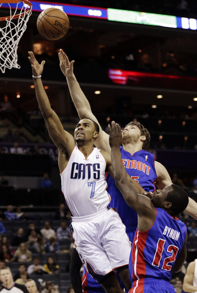 Charlotte Bobcats' Ramon Sessions (7) drives past Detroit Pistons' Will Bynum (12) and Viacheslav Kravtsov (55) during the first half of an NBA basketball game in Charlotte, N.C., Wednesday, Feb. 20, 2013. (AP Photo/Chuck Burton)