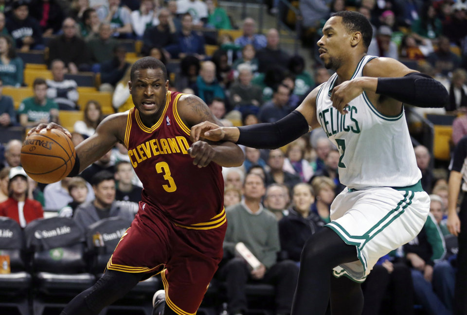 Photo - Cleveland Cavaliers' Dion Waiters (3) drives past Boston Celtics' Jared Sullinger (7) in the second quarter of an NBA basketball game in Boston, Saturday, Dec. 28, 2013. (AP Photo/Michael Dwyer)