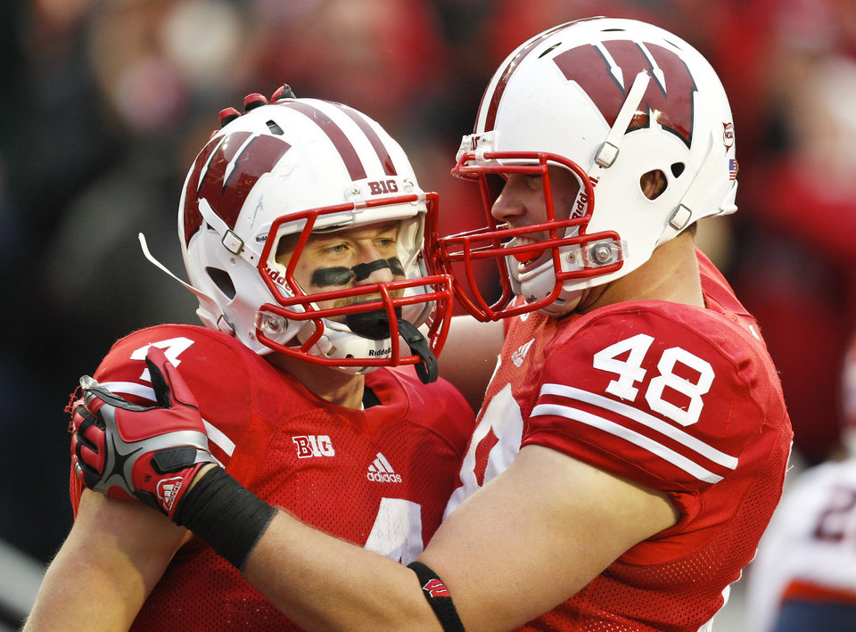 Photo -   Wisconsin's Jared Abbrederis, left, and Jacob Pedersen celebrate Abbrederis' touchdown during the second half of an NCAA college football game against Illinois, Saturday, Oct. 6, 2012, in Madison, Wis. Wisconsin won 31-14. (AP Photo/Andy Manis)