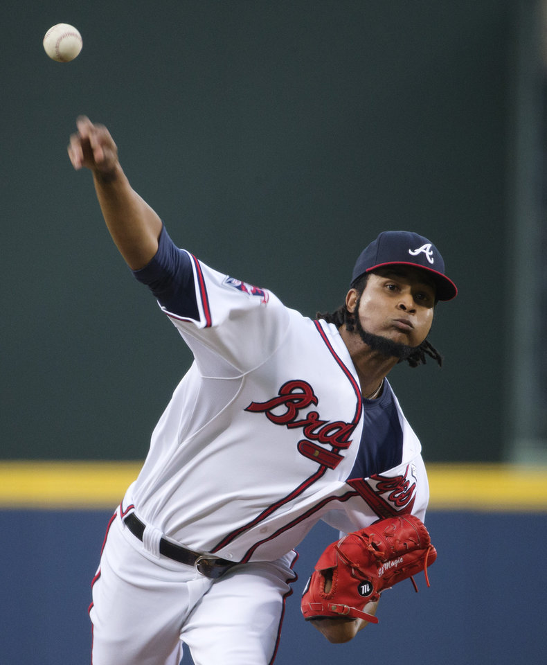 Photo - Atlanta Braves starting pitcher Ervin Santana throws in the first inning of a baseball game against the Miami Marlins, Friday, Aug. 29, 2014, in Atlanta. (AP Photo/David Goldman)