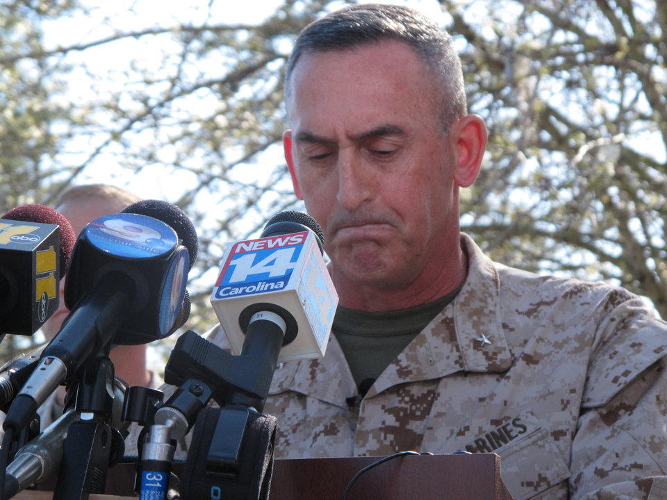 Photo - Marine Brig. Gen. Jim Lukeman address the media outside the gates of Camp Lejeune, N.C., on Tuesday, March 19, 2013. Seven Marines from the base were killed in a mortar accident in Nevada Monday night. (AP Photo/Allen Breed)
