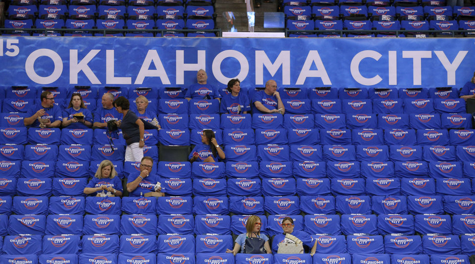 Photo - Fans take their seats before Game 1 of the Western Conference semifinals in the NBA playoffs between the Oklahoma City Thunder and the Los Angeles Clippers at Chesapeake Energy Arena in Oklahoma City, Monday, May 5, 2014. Photo by Bryan Terry, The Oklahoman