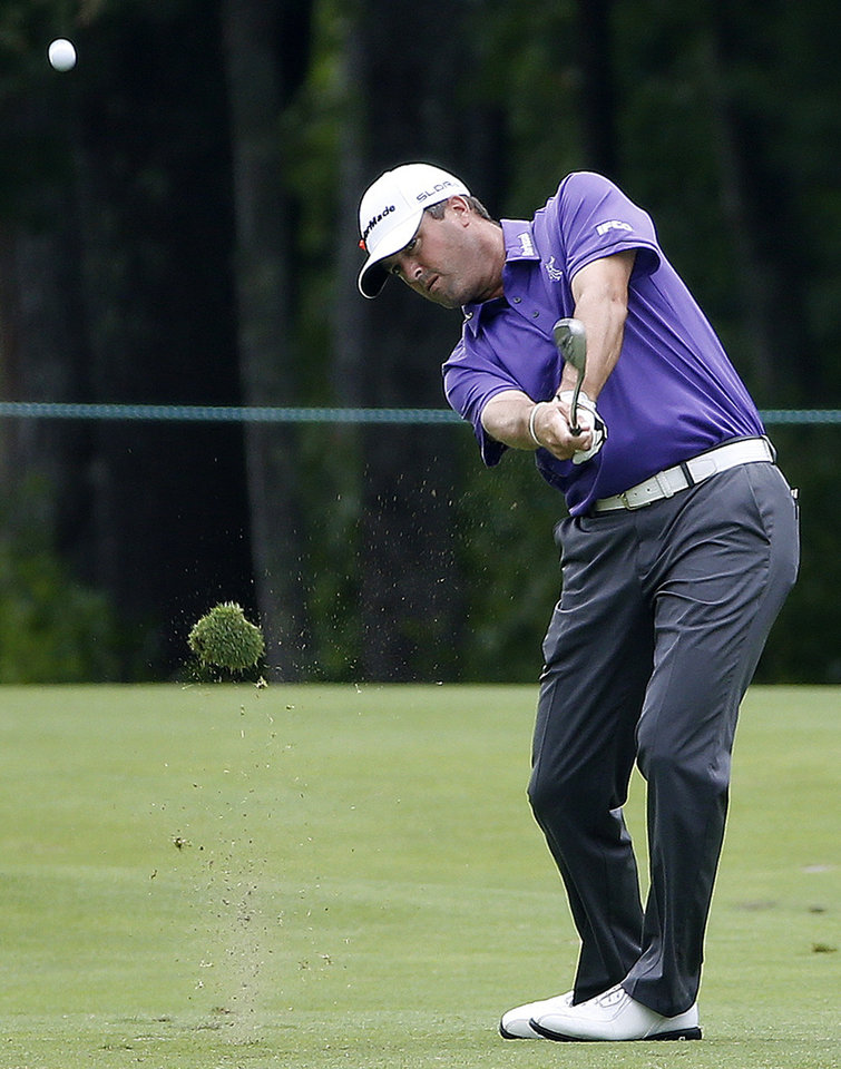 Photo - Ryan Palmer hits from the second fairway after taking a drop on his second shot during the third round of the Deutsche Bank Championship golf tournament in Norton, Mass., Sunday, Aug. 31, 2014. (AP Photo/Michael Dwyer)