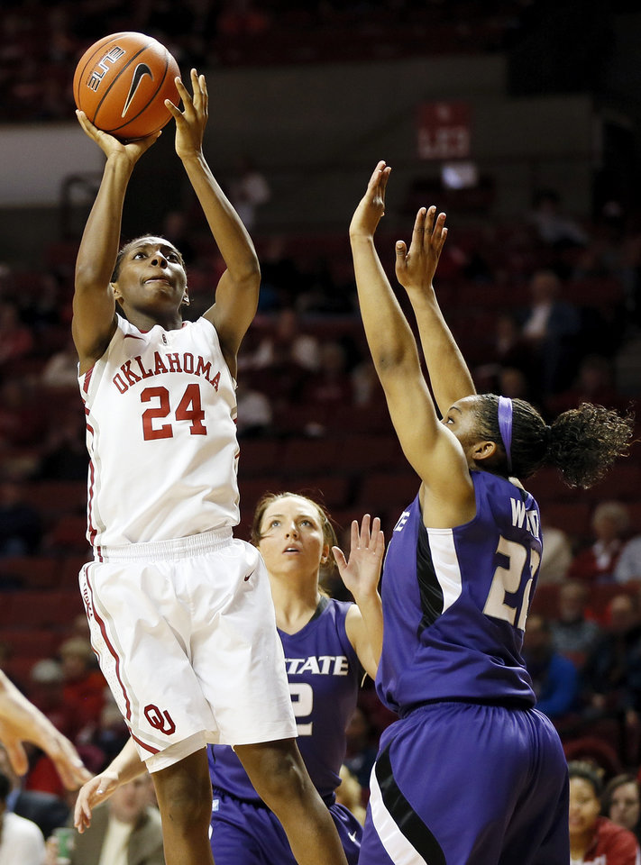 Photo - Oklahoma's Sharane Campbell (24) shoots between Kansas State's Brittany Chambers (2) and Mariah White (22) during an NCAA women's college basketball game between the University of Oklahoma (OU) and Kansas State at Lloyd Noble Center in Norman, Okla., Wednesday, Feb. 20, 2013. Photo by Nate Billings, The Oklahoman