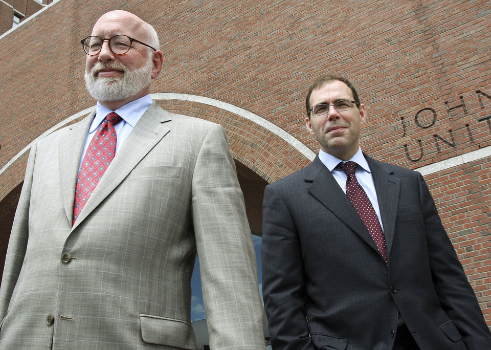 "Defense attorneys for James ""Whitey"" Bulger, J.W. Carney Jr., left, and Henry Brennan, right, leave U.S. District Court in Boston after the first day of Bulger's trial Wednesday, June 12, 2013.  Bulger faces a long list of crimes, including extortion and playing a role in 19 killings. (AP Photo/Bill Sikes)"