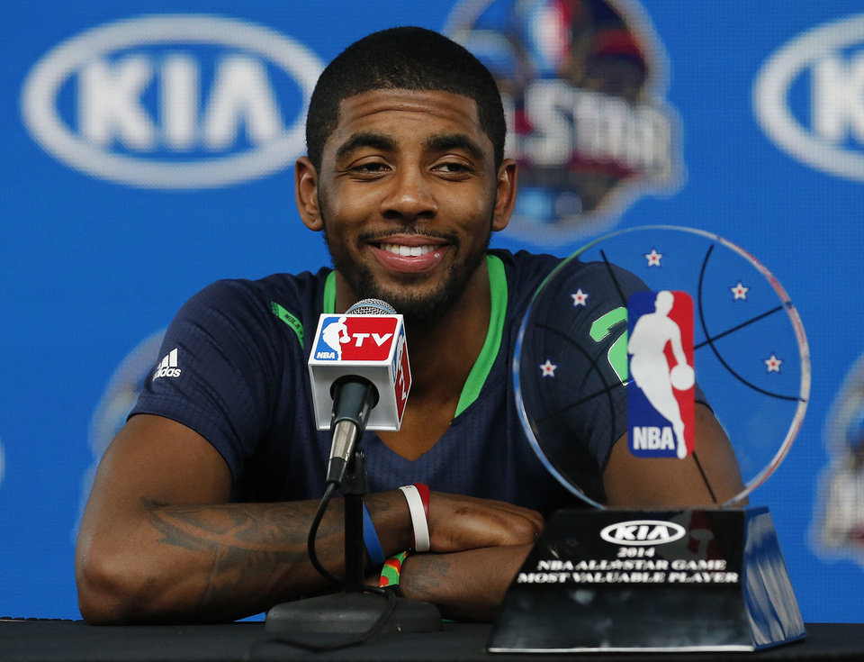 Photo - East Team's Kyrie Irving, of the Cleveland Cavaliers speaks during a news conference with his All Star MVP trophy after the NBA All Star basketball game, Sunday, Feb. 16, 2014, in New Orleans. (AP Photo/Bill Haber)