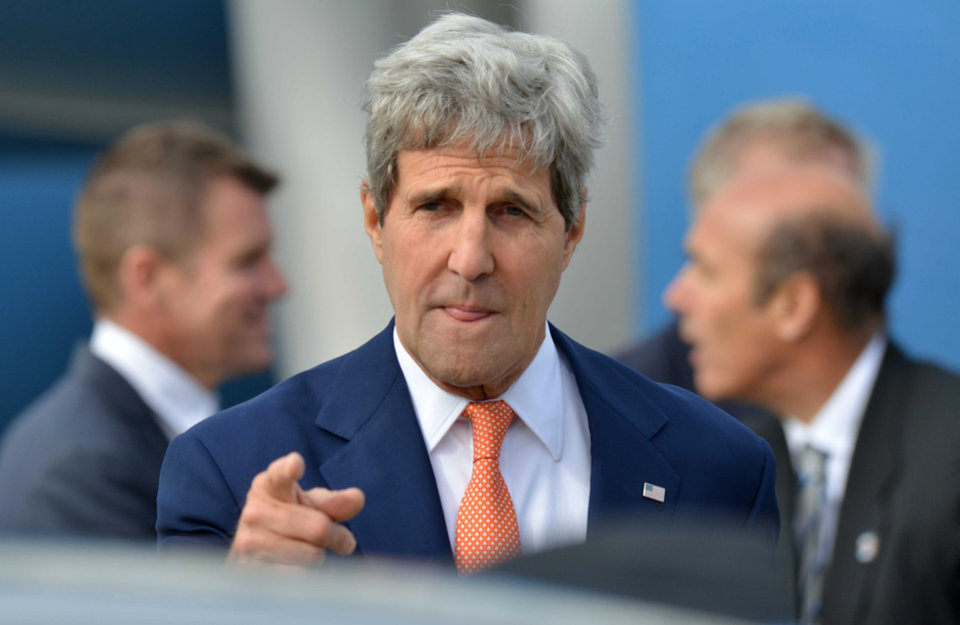 Photo - U.S. Secretary of State John Kerry points a finger as he arrives in Sydney, Monday, Aug. 11, 2014. Kerry and US Secretary of Defense Chuck Hagel are in Sydney for the annual Australia-United States Ministerial (AUSMIN) talks. (AP Photo/Peter Parks, Pool)